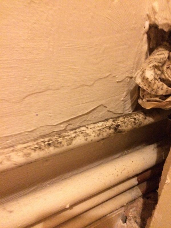 Dirty, dusty exposed radiator pipes