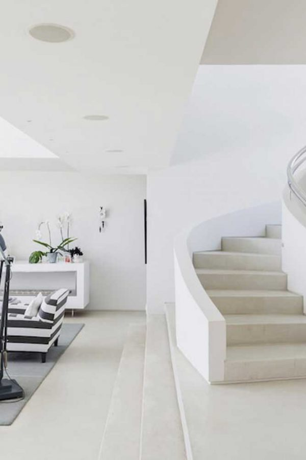Bright white room with spiral staircase