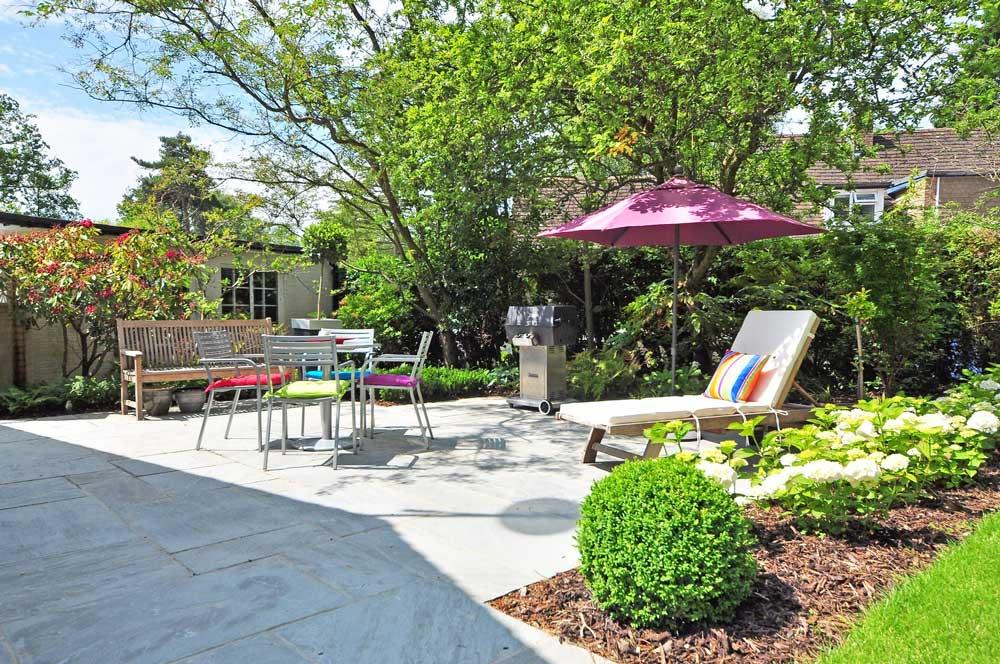 outdoor furniture on sunny patio garden