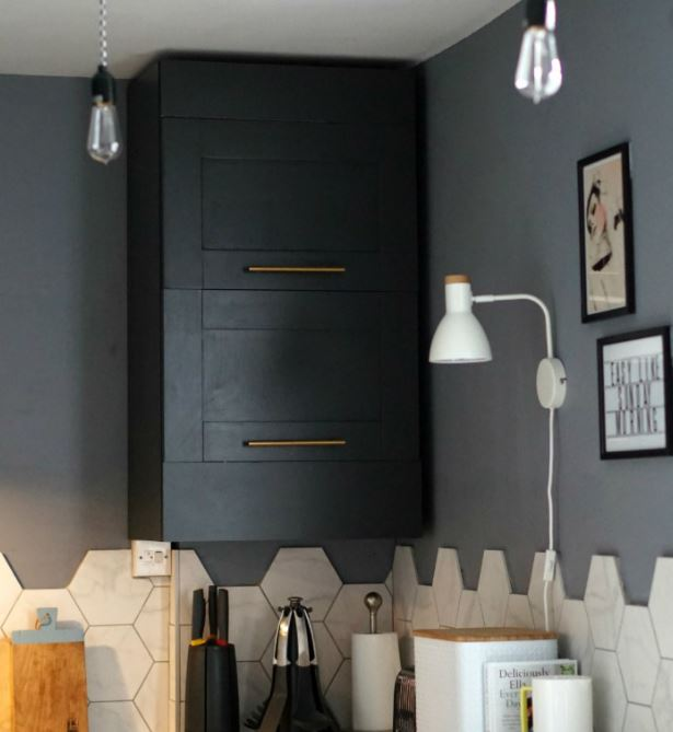 concealed boiler cupboard with tiled pipes panel