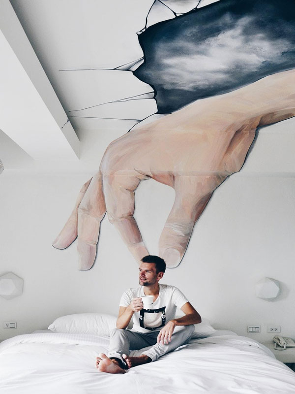 Giant hand painting over bed