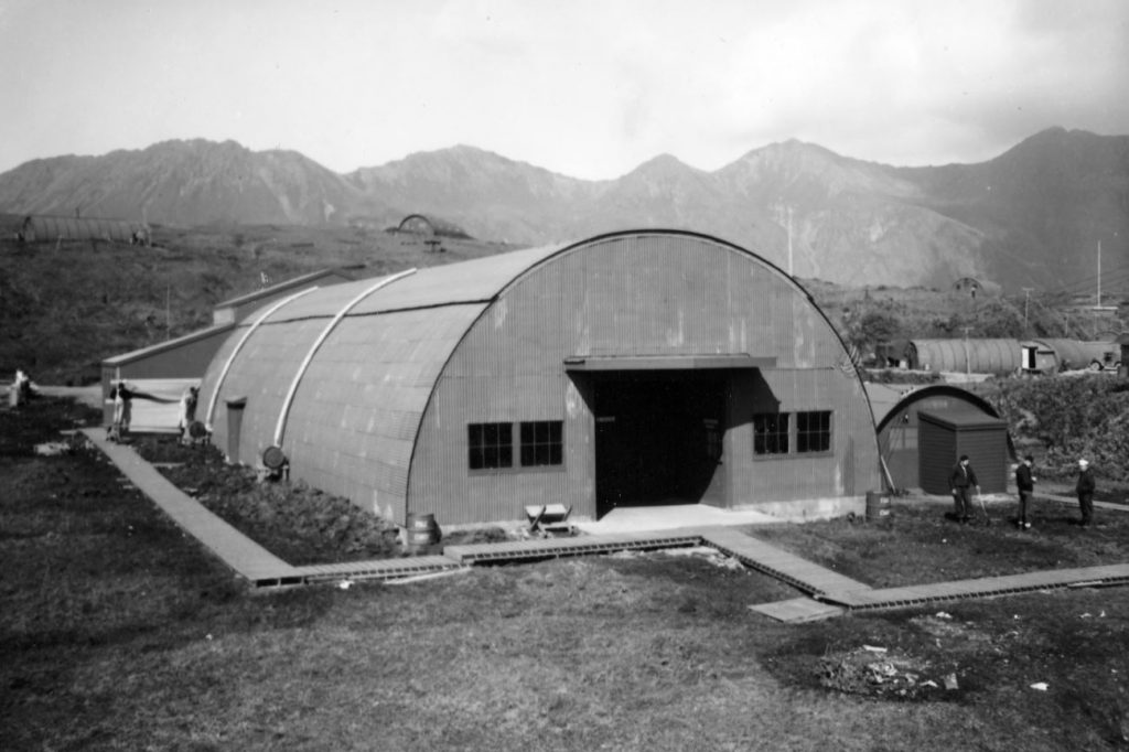An early example of a Quonset hut used for industry in world war 2