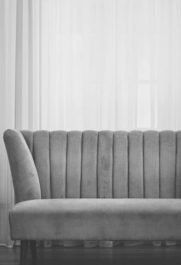 black and white photo of velvet couch